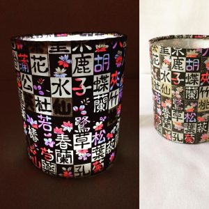 Little LED lit lanterns hand made with hand printed Japanese...