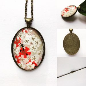 Pendant on a 24 inch chain. Japanese Chiyogami paper encased...